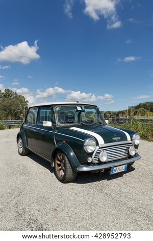 IVREA, ITALY - AUGUST 25, 2015: British green Mini Cooper on a sunny day