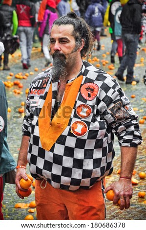 IVREA - MARCH 3: Carnival of Ivrea. The battle of oranges. An unidentified member of Chess team. On March 3, 2014 Ivrea, Italy. - stock photo