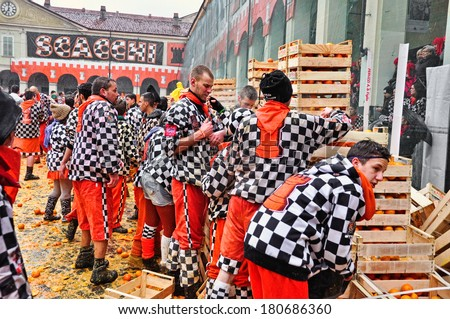 IVREA - MARCH 3: Carnival of Ivrea. The battle of oranges. Unidentified players of Chess team before the throwing. On March 3, 2014 Ivrea, Italy. - stock photo
