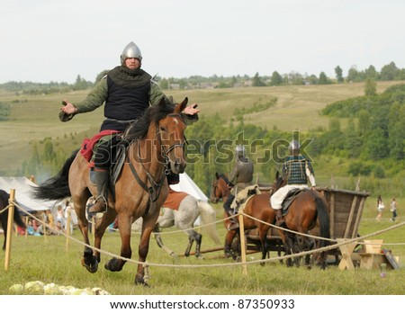 "IZBORSK, RUSSIA - AUGUST 6: Unidentified horsemen in medieval clothes take part in festival ""Iron hailstones"" on August, 6 2011 in Izborsk, the Pskov area, Russia."