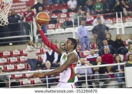 IZMIR DECEMBER 14: Pinar Karsiyaka's KENNY KENNETH BENARD GABRIEL lay up to the basket in Turkish Basketball League game between Pinar Karsiyaka 73-74 Darussafaka Dogus on December 14, 2015 in Izmir - stock photo