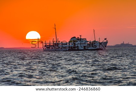 Izmir ferry services in the Gulf of Izmir at sunset - stock photo
