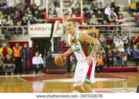 IZMIR - JANUARY 10: Pinar Karsiyaka's COLTON IVERSON drives to the basket in Turkish Basketball League game between Pinar Karsiyaka 87-83 Akin Corap Yesilgiresun on January 10, 2016 in Izmir - stock photo