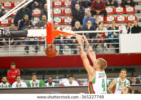 IZMIR JANUARY 20: Pinar Karsiyaka's COLTON IVERSON slam dunks to the basket in Eurocup game between Pinar Karsiyaka 79-85 Dolomiti Energia Trento on January 20, 2016 in Izmir - stock photo