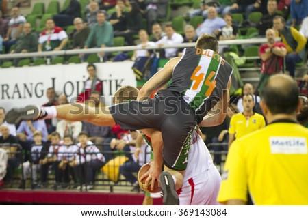 IZMIR - JANUARY 10: Pinar Karsiyaka's COLTON IVERSON stopped by foul in Turkish Basketball League game between Pinar Karsiyaka 87-83 Akin Corap Yesilgiresun on January 10, 2016 in Izmir - stock photo