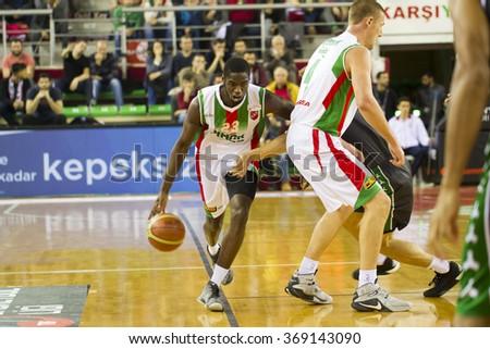 IZMIR - JANUARY 10: Pinar Karsiyaka's JOSHUA CARTER drives to the basket in Turkish Basketball League game between Pinar Karsiyaka 87-83 Akin Corap Yesilgiresun on January 10, 2016 in Izmir - stock photo