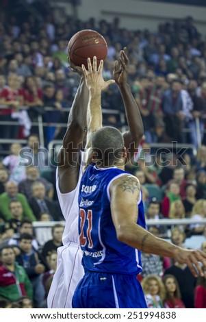 IZMIR -JANUARY 28: Pinar Karsiyaka's Juan Palacios shoots to the basket in Eurocup game between Pinar Karsiyaka 86-79 Paris Levallois on January 28, 2015 in Izmir - stock photo
