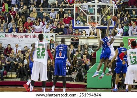 IZMIR -JANUARY 28: Pinar Karsiyaka's Juan Palacios slam dunks in Eurocup game between Pinar Karsiyaka 86-79 Paris Levallois on January 28, 2015 in Izmir - stock photo