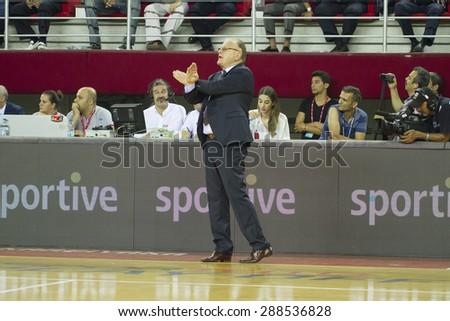 IZMIR   JUNE 16: Anadolu Efes's Coach DUSAN IVKOVIC standing near the bench in Turkish Basketball League game between Pinar Karsiyaka 91-88 Anadolu Efes on June 16, 2015 in Izmir - stock photo