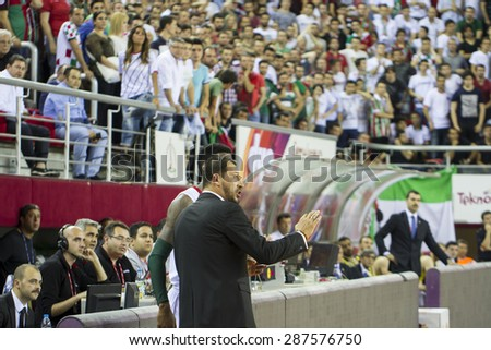 IZMIR - JUNE 06: Pinar Karsiyaka's Coach UFUK SARICA gives tactics to KENNETH BENARD GABRIEL in Turkish Basketball League game between Pinar Karsiyaka 82-64 Fenerbahce Ulker on June 06, 2015 in Izmir - stock photo