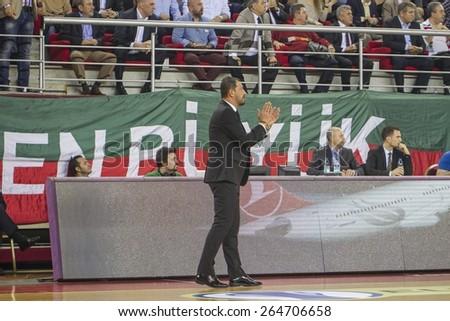 IZMIR  MARCH 25: Pinar Karsiyaka's Coach UFUK SARICA standing in Eurocup game between Pinar Karsiyaka 74-75 Gran Canaria on March 25, 2015 in Izmir - stock photo