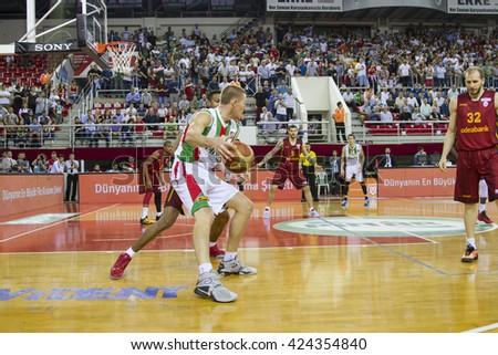 IZMIR - MAY 20: Pinar Karsiyaka's COLTON IVERSON post up playing in Turkish Basketball League game between Pinar Karsiyaka 62-65 Galatasaray Odeabank on May 20, 2016 in Izmir - stock photo