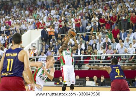 IZMIR - OCTOBER 15: Pinar Karsiyaka's Joe RAGLAND shoots to the basket in Turkish Airlines Euroleague game between Pinar Karsiyaka 71-62 Barcelona Lassa on October 15, 2015 in Izmir - stock photo