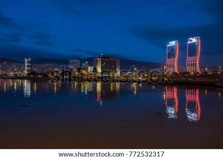 Izmir, Turkey - December 10, 2017 : New skycrapers district of Izmir City night view from sea. Izmir is the third biggest city of Turkey.