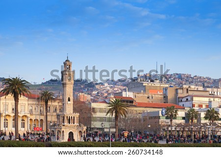 Izmir, Turkey - February 5, 2015: Konak Square with tourists walking near the historical clock tower. It was built in 1901 and accepted as the symbol of Izmir City - stock photo