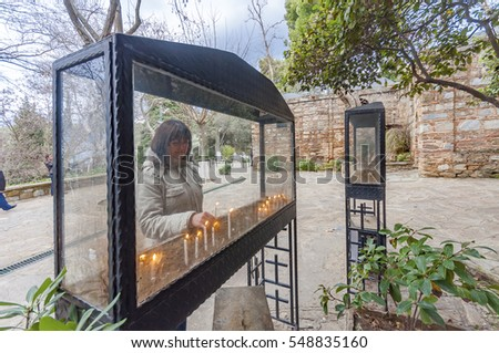 Izmir, Turkey - January 13, 2012 : People are visiting Virgin Mary's House. and burning candle. The House of Virgin Mary is populer tourist attraction in Turkey.