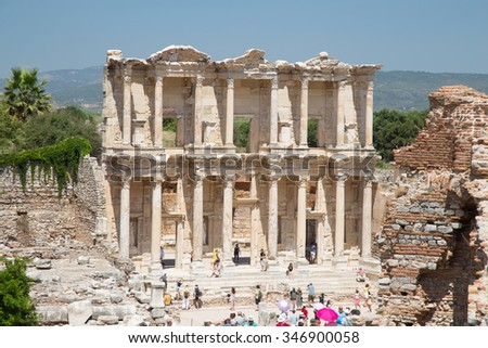 IZMIR, TURKEY - JULY 13, 2015:  People visit Library of Celsus in Ephesus. ibrary of Celsus built in 117 A.D. and one of the most touristy place in Turkey.