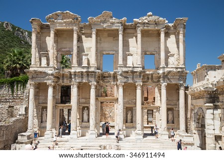 IZMIR, TURKEY - JULY 13, 2015:  People visit Library of Celsus in Ephesus. ibrary of Celsus built in 117 A.D. and one of the most touristy place in Turkey.  - stock photo