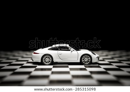 Izmir, Turkey - 1 June, 2015: Porsche 911 carrera s toy model car product shot. - stock photo