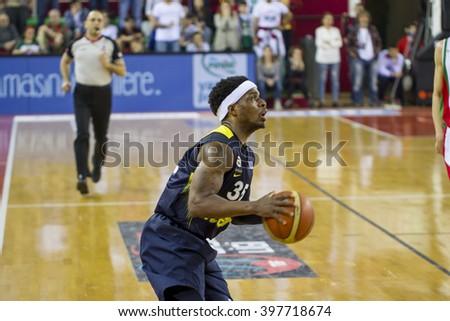 IZMIR, TURKEY - MARCH 20: Fenerbahce Ulker's ALI MUHAMMED BOBBY DIXON  shooting in Turkish Basketball League game between Pinar Karsiyaka 86-81 Fenerbahce Ulker on March 20, 2016 in Izmir - stock photo