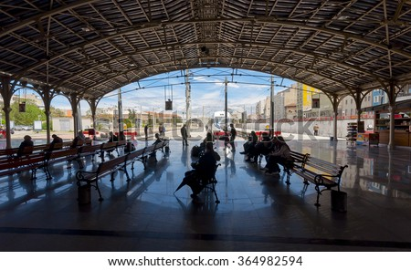 Izmir, Turkey - May 05, 2011 : Covered railway station with trains and silhouettes of waiting people in Basmane Train Station, Izmir - stock photo