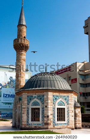 IZMIR, TURKEY - OCTOBER 04, 2014: Yali Mosque called Konak Mosque, famous octagonal shaped landmark at the Konak Square, built in 1755. Dome and minaret - stock photo