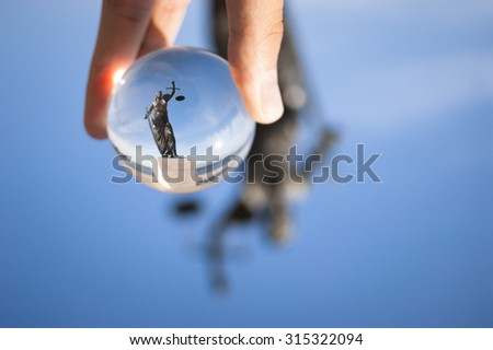 Izmir, Turkey - September 9, 2015: Justice sculpture picture from a glass ball. - stock photo