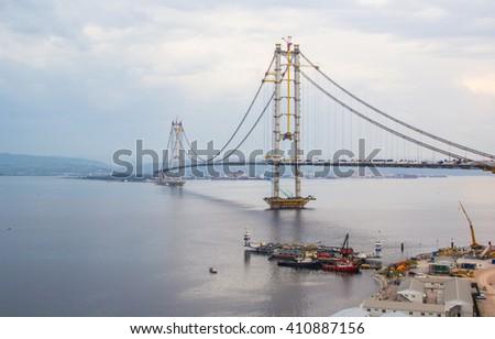 IZMIT, TURKEY - April 24, 2016; The Osman Gazi Bridge aka Izmit Bay Bridge is a suspension bridge under construction, located at the Gulf of Izmit along the eastern end of the Sea of Marmara
