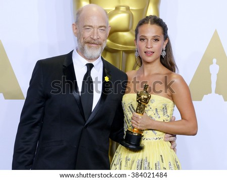 J.K. Simmons and Alicia Vikander at the 88th Annual Academy Awards - Press Room held at the Loews Hollywood Hotel in Hollywood, USA on February 28, 2016.