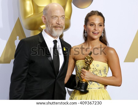 J.K. Simmons and Alicia Vikander at the 88th Annual Academy Awards - Press Room held at the Loews Hotel in Hollywood, USA on February 28, 2016.
