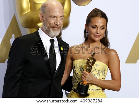 J.K. Simmons and Alicia Vikander at the 88th Annual Academy Awards - Press Room held at the Loews Hotel in Hollywood, USA on February 28, 2016. - stock photo
