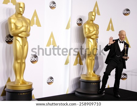 J.K. Simmons poses in the press room during the 87th Annual Academy Awards at Loews Hollywood Hotel on February 22, 2015 in Hollywood, California. - stock photo