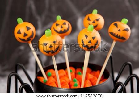 Jack-o-lantern cake pops - stock photo