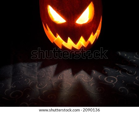 Jack-o-lantern, Halloween pumpkin glowing in the night - stock photo