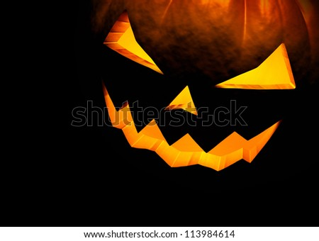 Jack O Lantern halloween pumpkin on black background. Close up with copy space. 3d render - stock photo