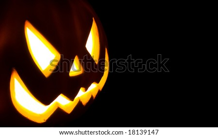 Jack-o-lantern isolated on a black background - stock photo