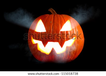 Jack-o'-lantern with smoke - stock photo