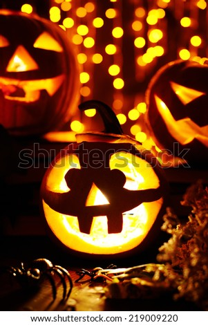 Jack-o-lanterns and spiders on sparkling background - stock photo