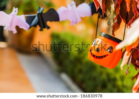 Jack O Lanterns - Halloween decoration hanging from the branch - stock photo