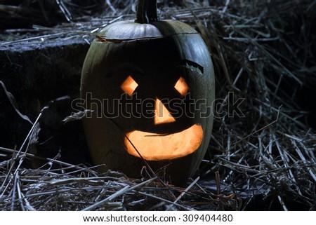 Jack O lanterns pumpkin on straw - halloween night - stock photo