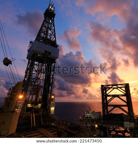 Jack Up Oil Drilling Rig At Sun Rise Time - stock photo