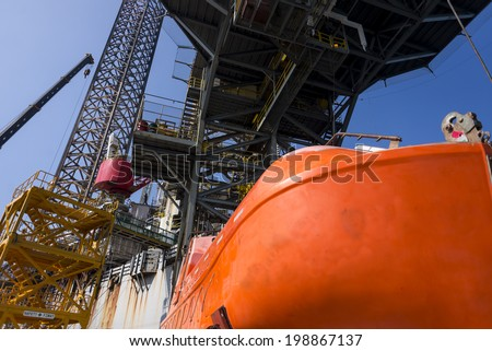 Jack up oil with almost fully leg up at shipyard at bow area
