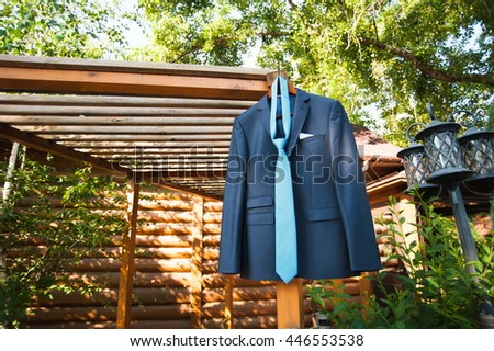 Jacket and tie of the groom in nature