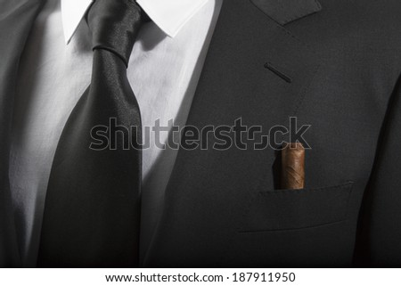 Jacket and tie with cuban cigar in the pocket, Italian fashion concept - stock photo
