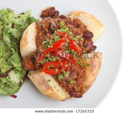 Jacket potato with chilli - stock photo
