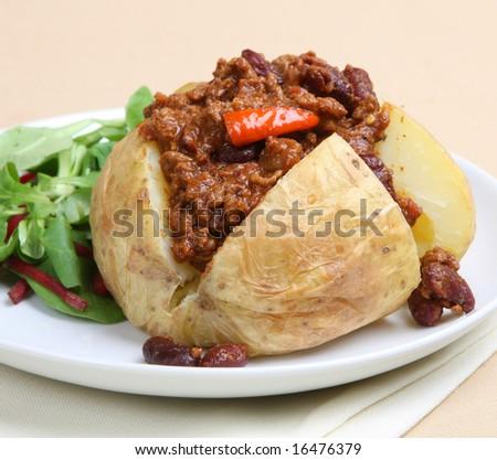 Jacket potato with Chilli con Carne - stock photo