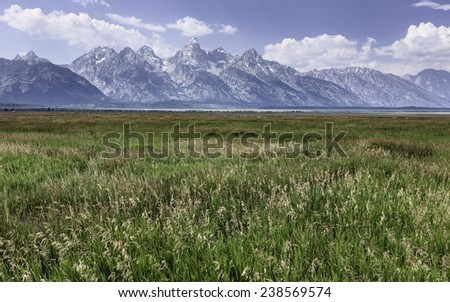 Jackson, Wyoming, USA - Open prairie stretching back to the Grand Tetons mountains near Mormon Row, Jackson, Wyoming, USA. - stock photo