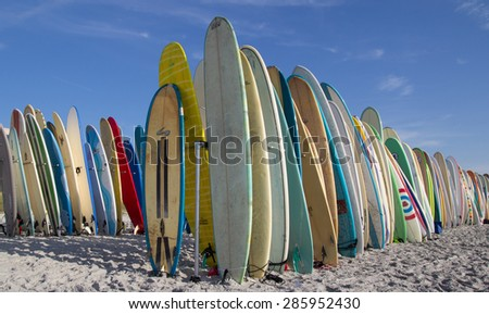 JACKSONVILLE BEACH, FL. USA - JUNE 6, 2015: Surfboards are staged on the beach for the Ocean Paddle part of the Never Quit Trident event which involves a 5k Run, 500M Ocean Swim and 1.5k Ocean Paddle. - stock photo