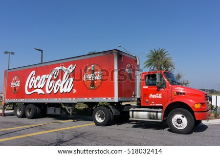 JACKSONVILLE, FL - NOVEMBER 17, 2016: A red Coca cola truck. The Coca-Cola Company is an American beverage corporation best known for its flagship product Coca-Cola, invented in 1886 by a pharmacist.