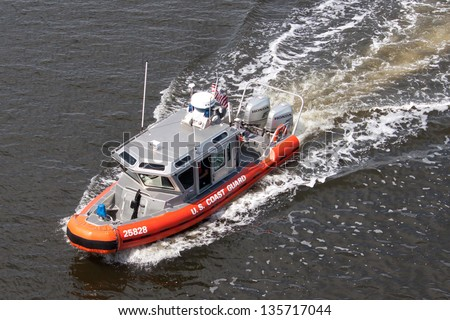 JACKSONVILLE, FLORIDA - MARCH 17: A US Coast Guard 25 Foot Defender Class Boat patrolling the waterways of Jacksonville, Florida on March 17, 2013. These boats first began service in May 2002. - stock photo